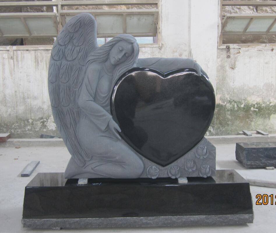 Buy Shanxi black angel monument for cemetery holding single heart