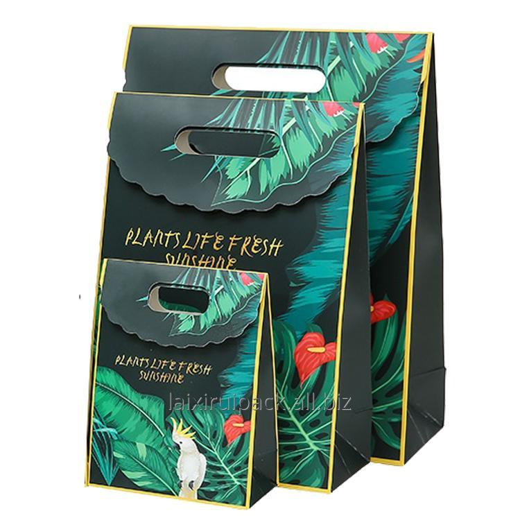 Buy Custom luxury die cut handle paper hand bag for gift packing