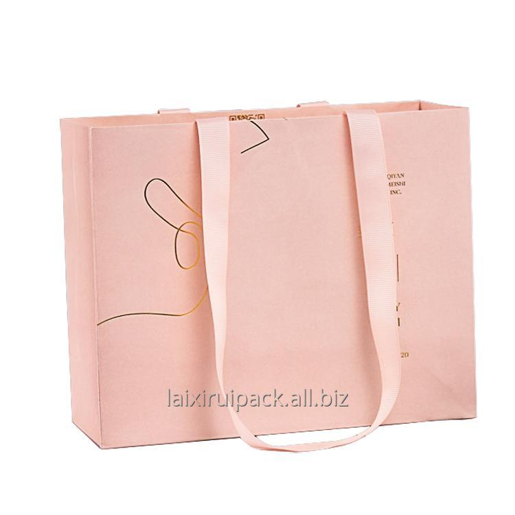 Buy Bespoke big size luxury shopping bag for clothing packaging paper bag with flat ribbon handle