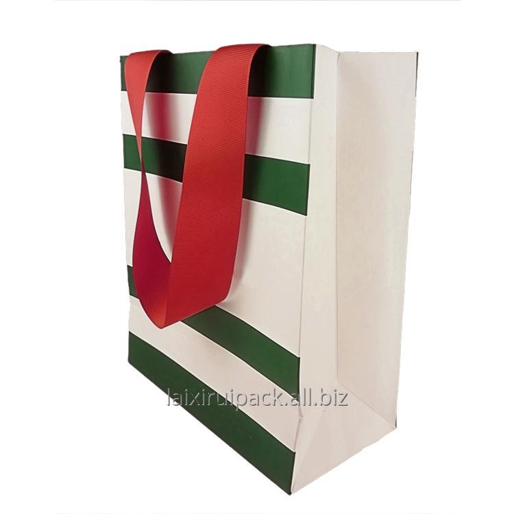 Buy Luxury strip design clothing shopping bag with flat ribbon handle high end paper packaging