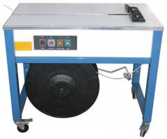 Machines for the binding by polypropylene tapes