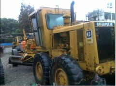 Machines for the treatment of road surfaces
