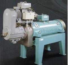 Centrifuges for pressing moisture and oils from