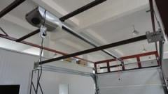Automatic sectional overhead garage door