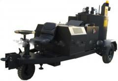 Machines for the building of asphalt-concrete