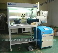 Vacuum glove box with microscope equipped