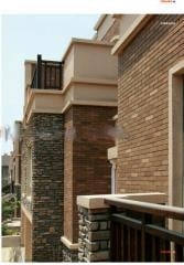 Decorative tile materials for facades of houses
