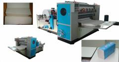 Machines for the production of paper towels adding