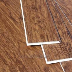 Sound absorbing vinyl cushion flooring