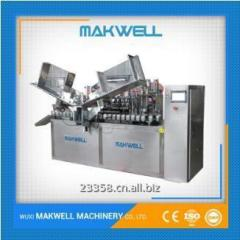 Automatic tube filling and sealing machine for