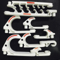 White color plastic hooking for hanging cables cable hook