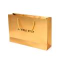 Шоколадна коробка чорного кольору квадратної форми із золотим папером всередині